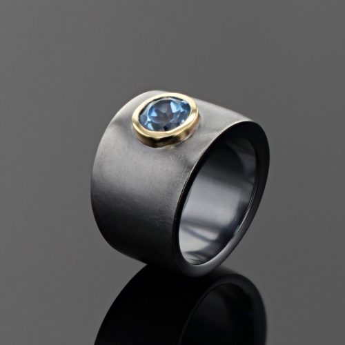 Solid black silver ring with Blue Topas