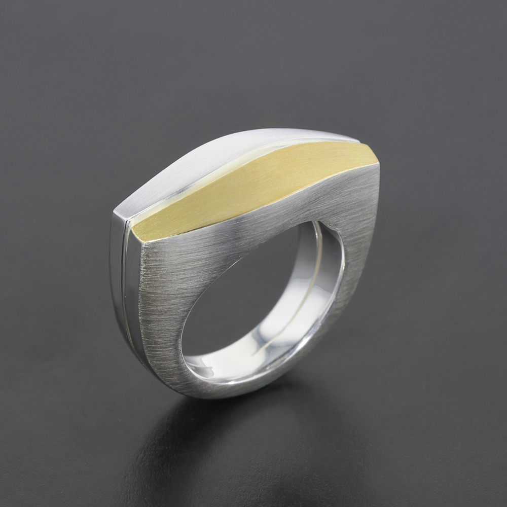 Silver wave ring with gold