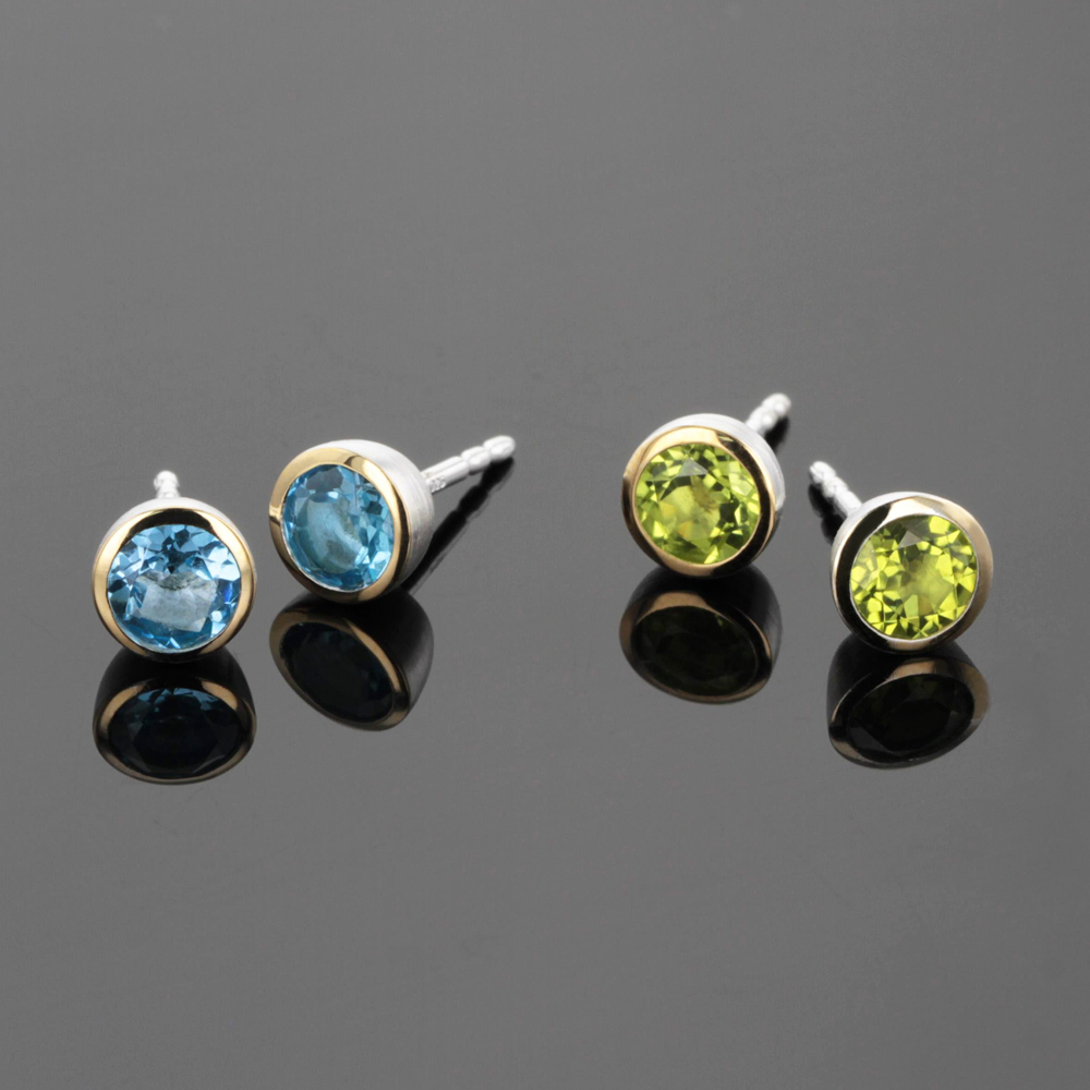Silver and gold earrings with peridot and blue topas