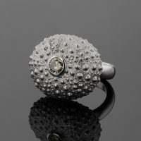 white gold sea urchin ring with champagner coloured diamond