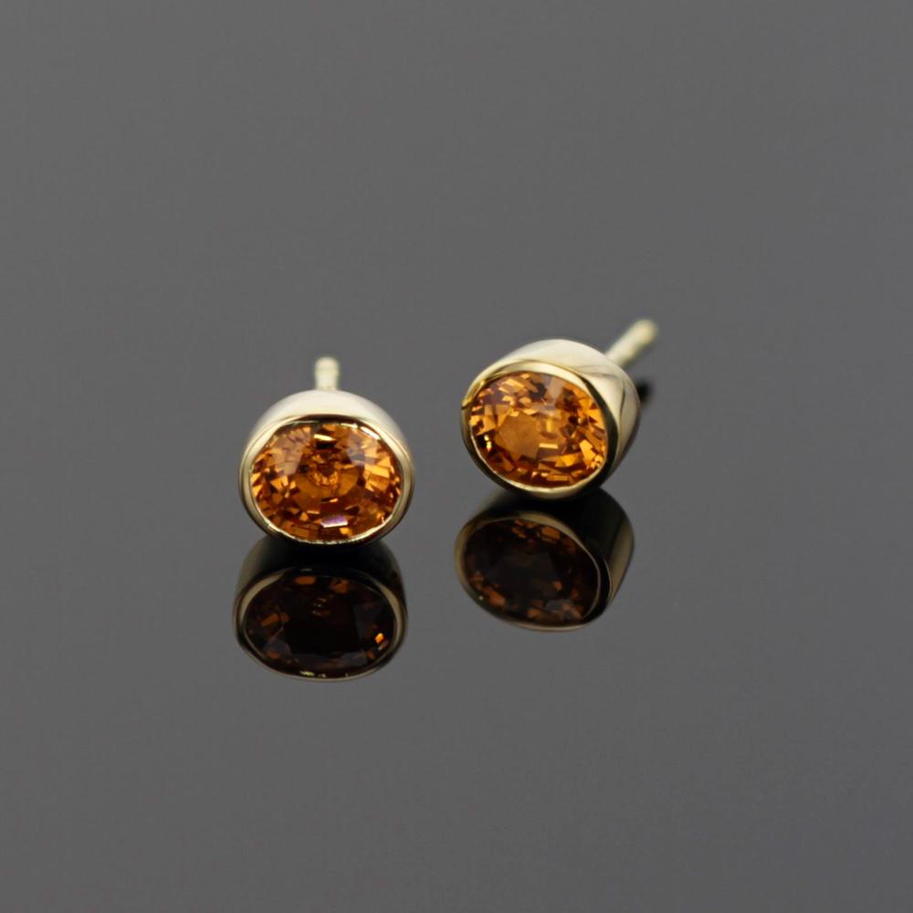 gold studs with Mandarine Garnets