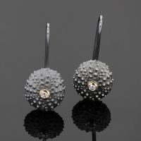 sea urchin earrings in oxidized silver with diamond set in gold