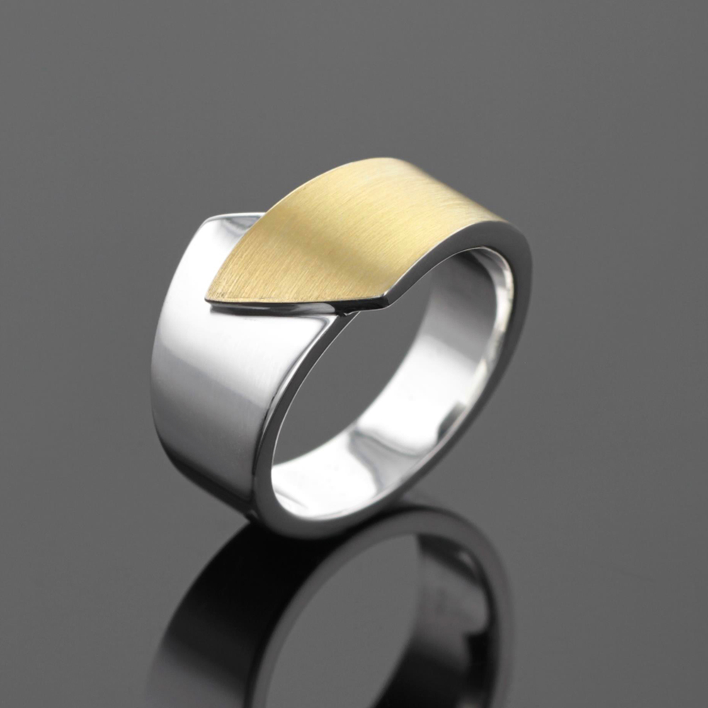 Modern silver and gold ring