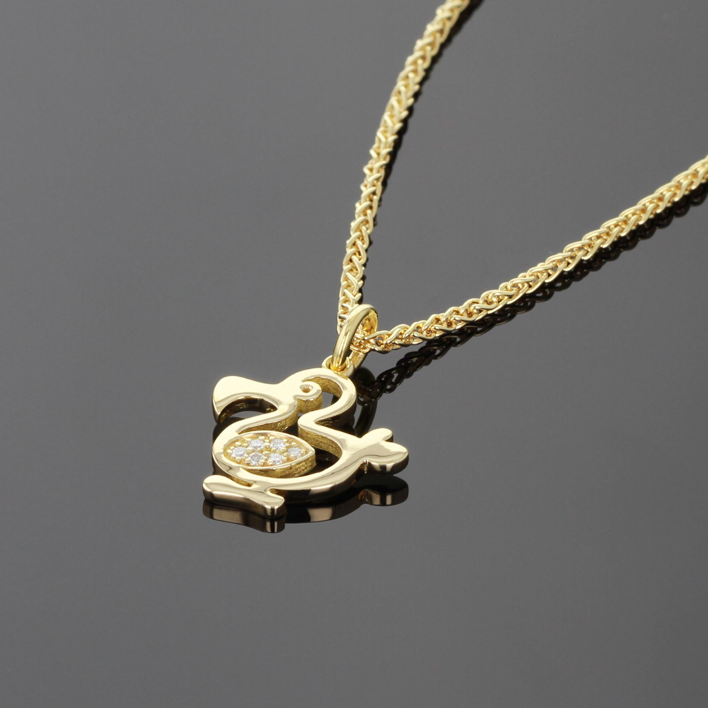 Diamond and gold dodo pendant